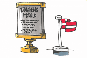 Et menuskilt og et dannebrogsflag