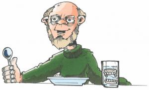 tandløs mand med et glas med gebis i